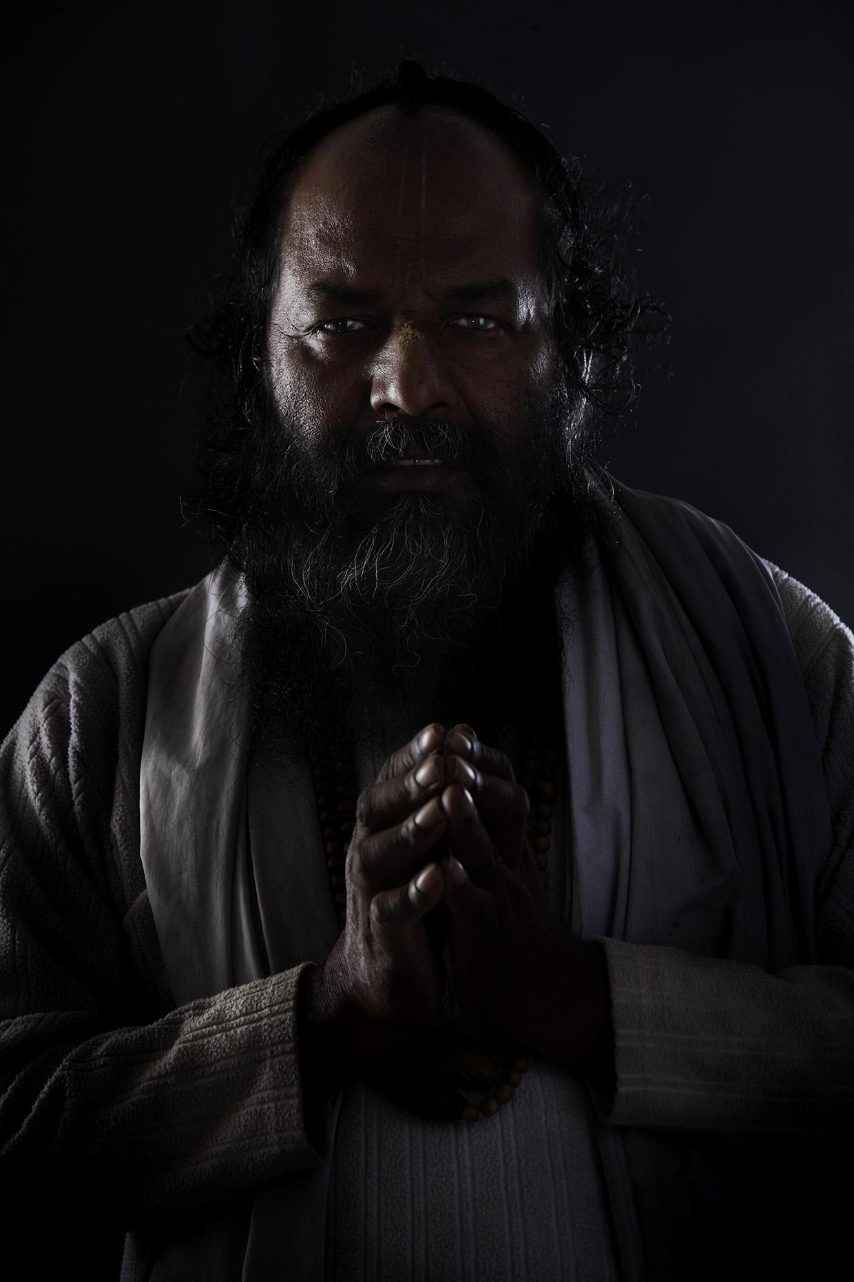 Dark Krishna posing in front of the camera at the Kumbh Mela