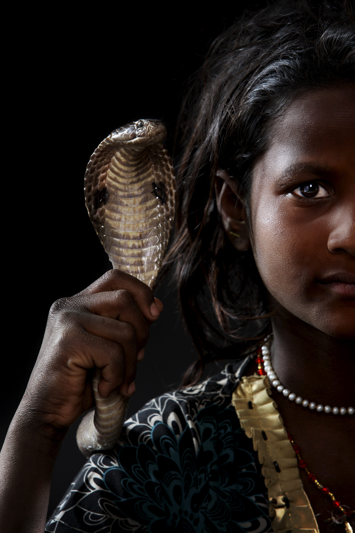 Photo of girl with cobra at the Kumbh Mela