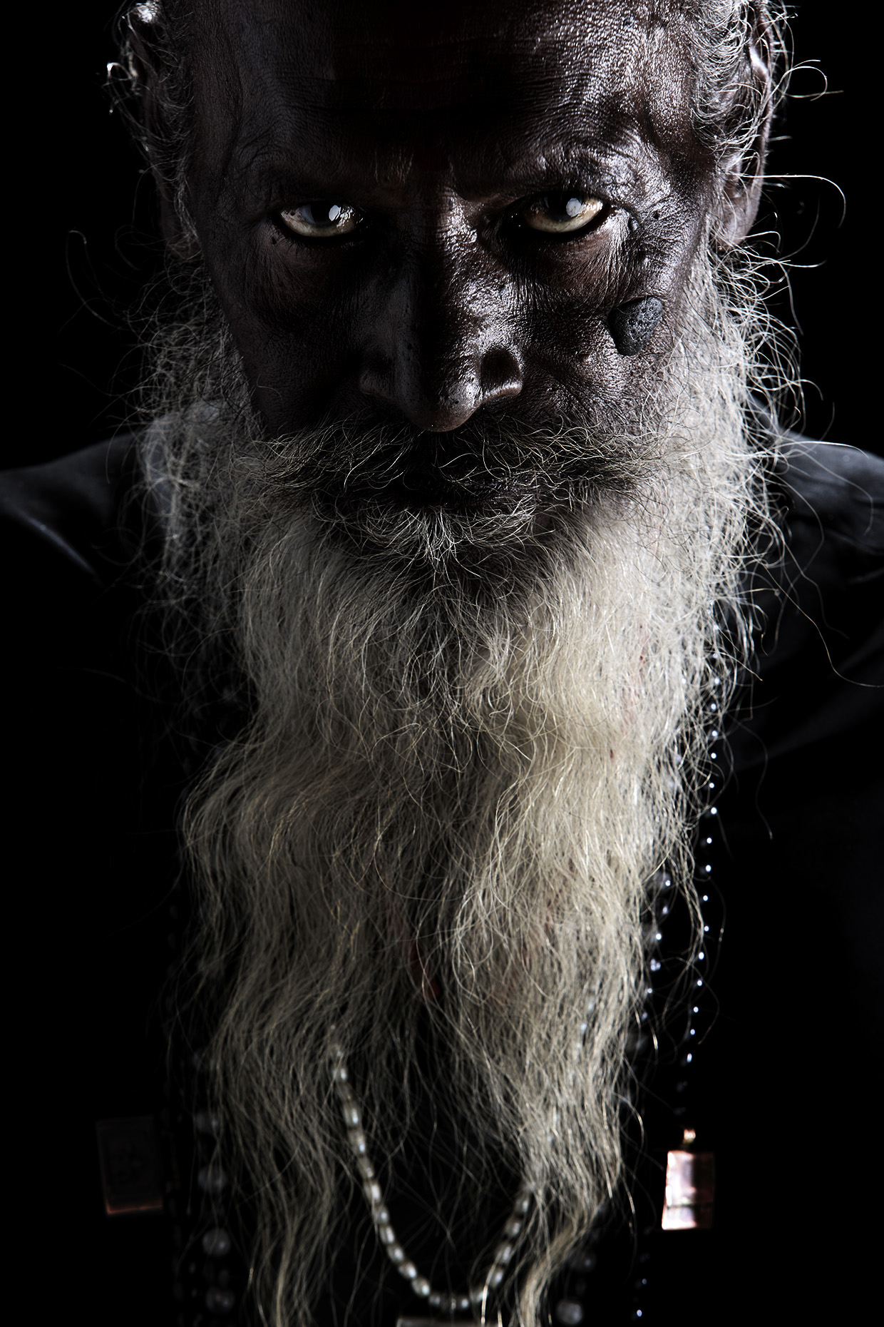 Studio portrait of white beard man at the Kumbh Mela