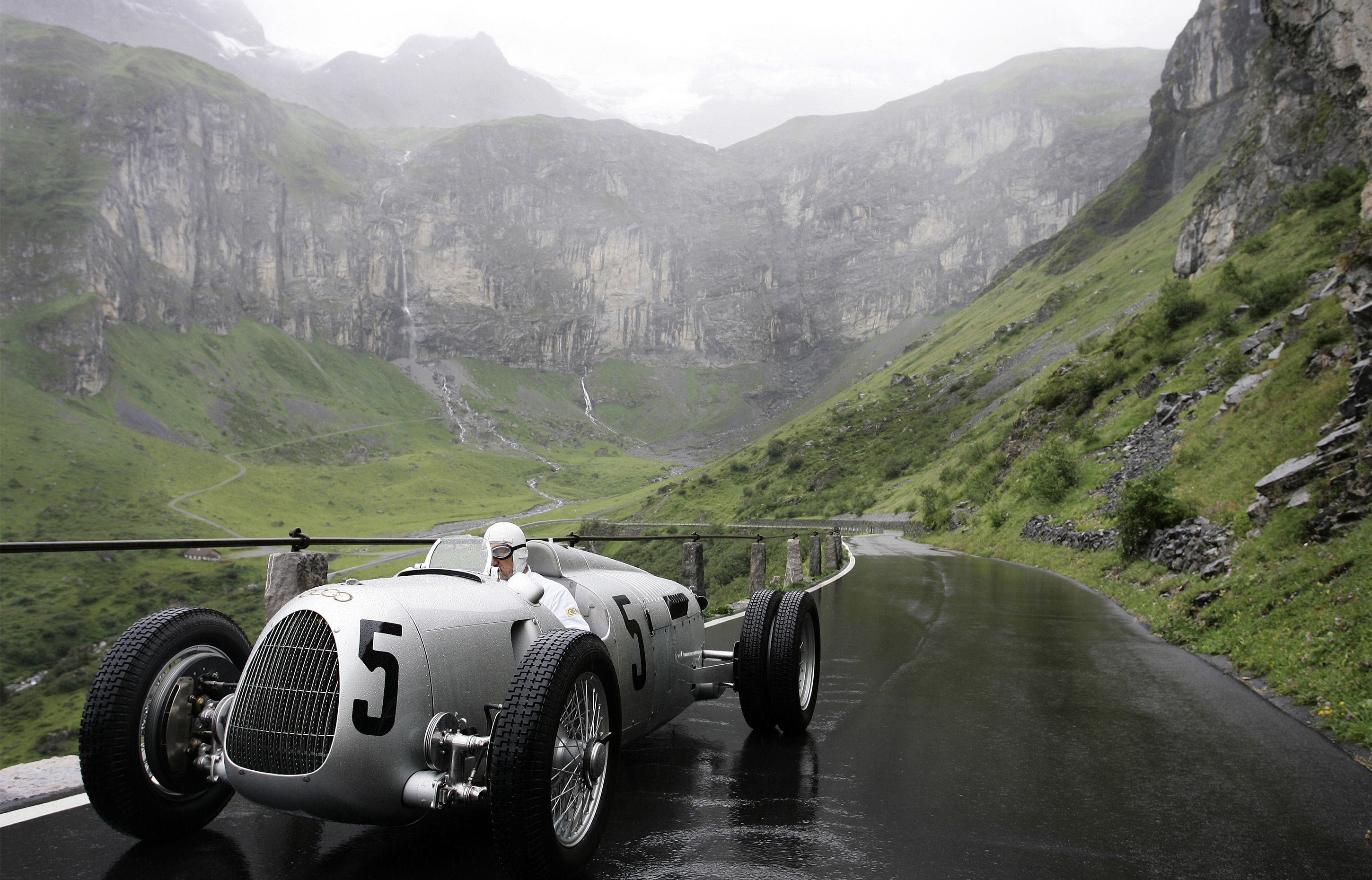 Klausen Pass, Switzerland - Classic 1937 Auto Union C-type races the Klausen Pass, Switzerland. The best racers in the world came together every year from 1922 to 1934 to race the Klausen Pass. Past performances by historic racers included Caracciola, Stuck, Nuvolari, and Chiron.