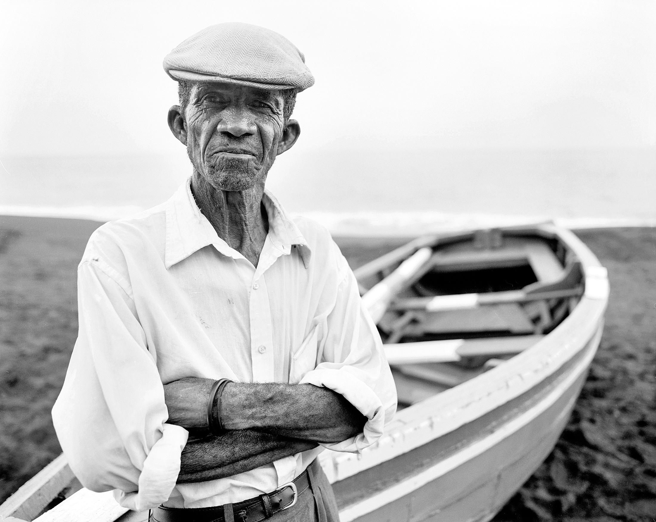Manuel in front of his fishing boat on the beach of São Filipe. The attraction of traveling is the encounter along the way. It's the exchange with Locals and the opportunity to participate in their lives and traditions.
