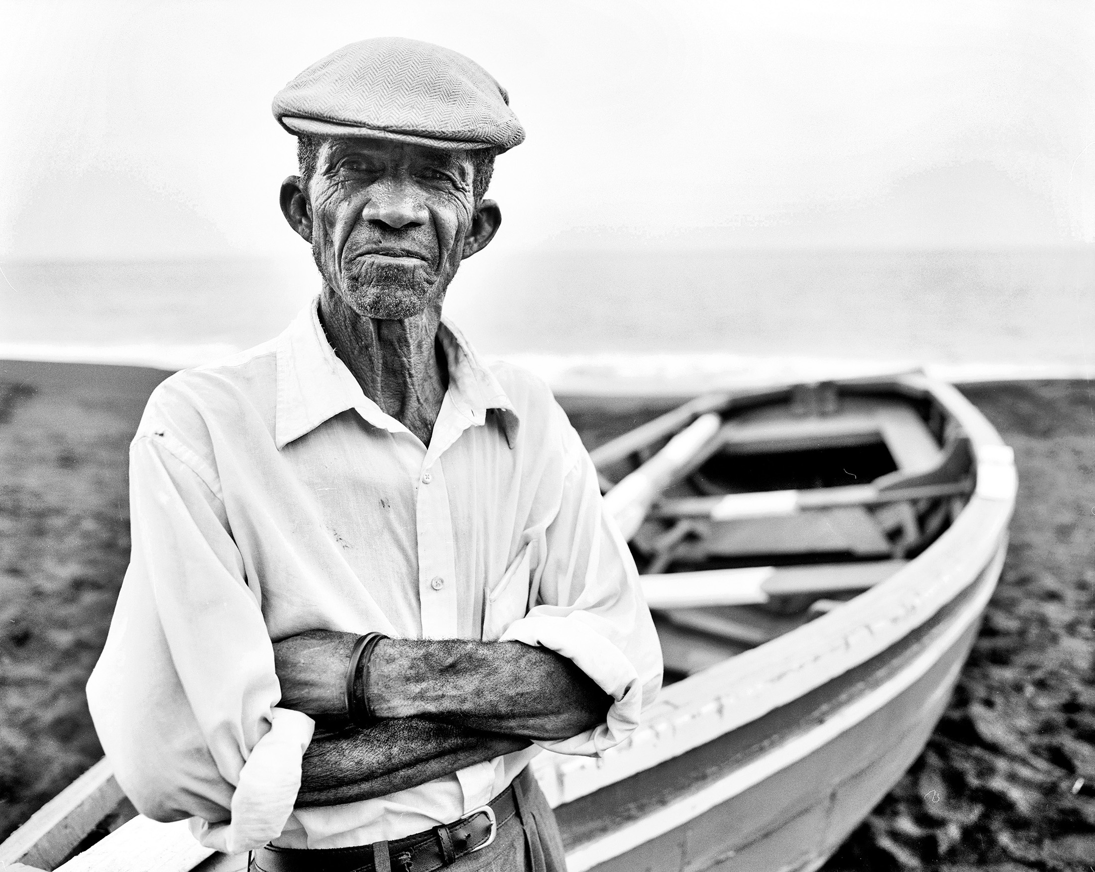 Fisherman in front of his boat on the beach of Sao Filipe