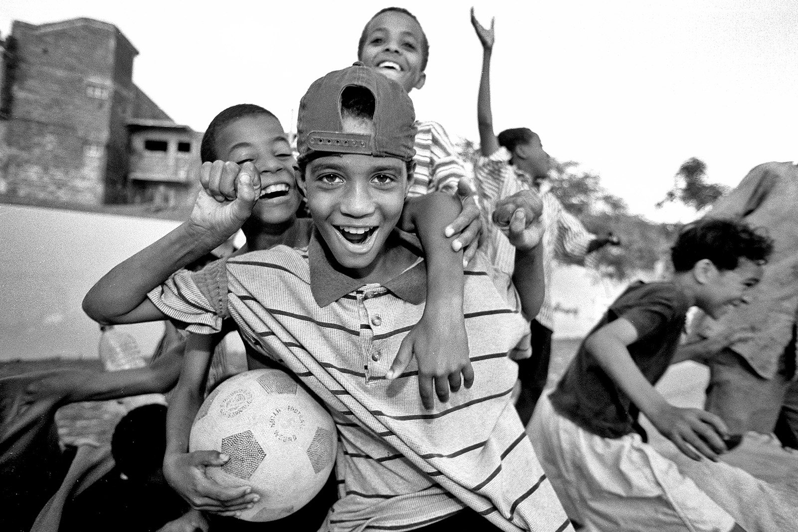 Happy kids playing football